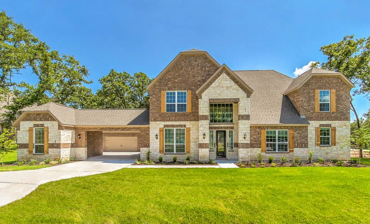 The Ryan by Terrata Homes:Breathtaking two-story home with a brick and stone exterior.