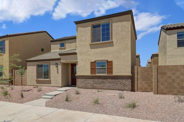 The La Paz by LGI Homes:Welcome home to a gorgeous front exterior and landscaped yard.
