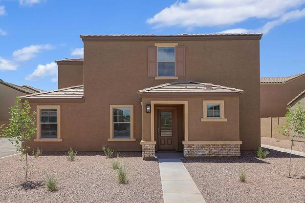 The Mohave plan by LGI Homes:Front yard landscaping and a covered front entry welcome you home.