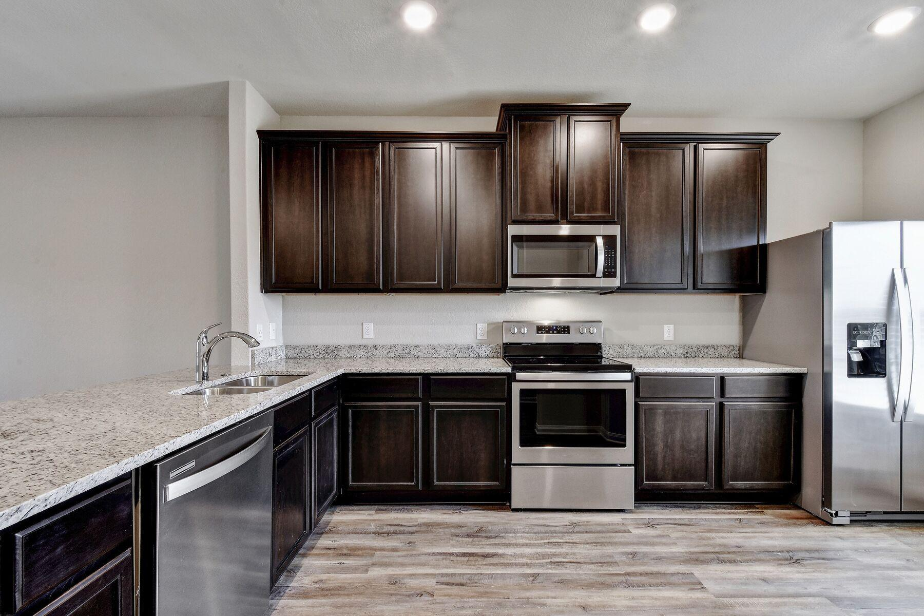 Kitchen featured in the Victoria By LGI Homes in Austin, TX