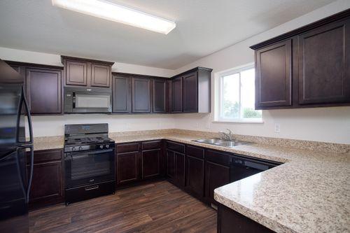 Kitchen-in-The Cedar Split Level - LGI Homes-at-Sanford Select Acres-in-Big Lake