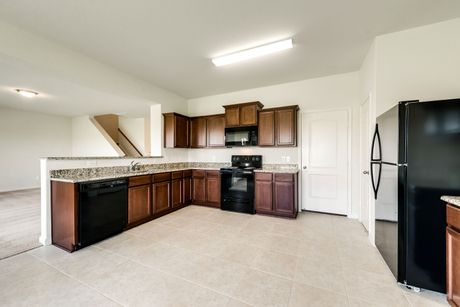 Kitchen-in-Higgins-at-North Pointe Crossing-in-Anna