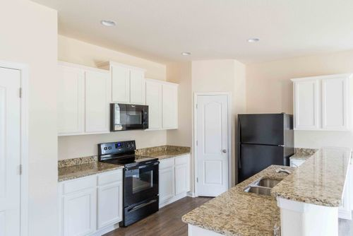 Kitchen-in-Avery-at-The Reserve at Canyon Hills-in-Charlotte