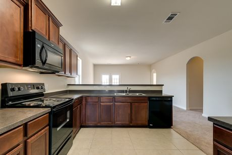 Kitchen-in-Maple-at-The Reserve at Park Lakes-in-Humble