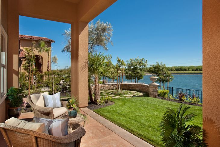Bella Vista Plan 2 Rear Patio: Relax with gorgeous views of the lake and lush vegetation