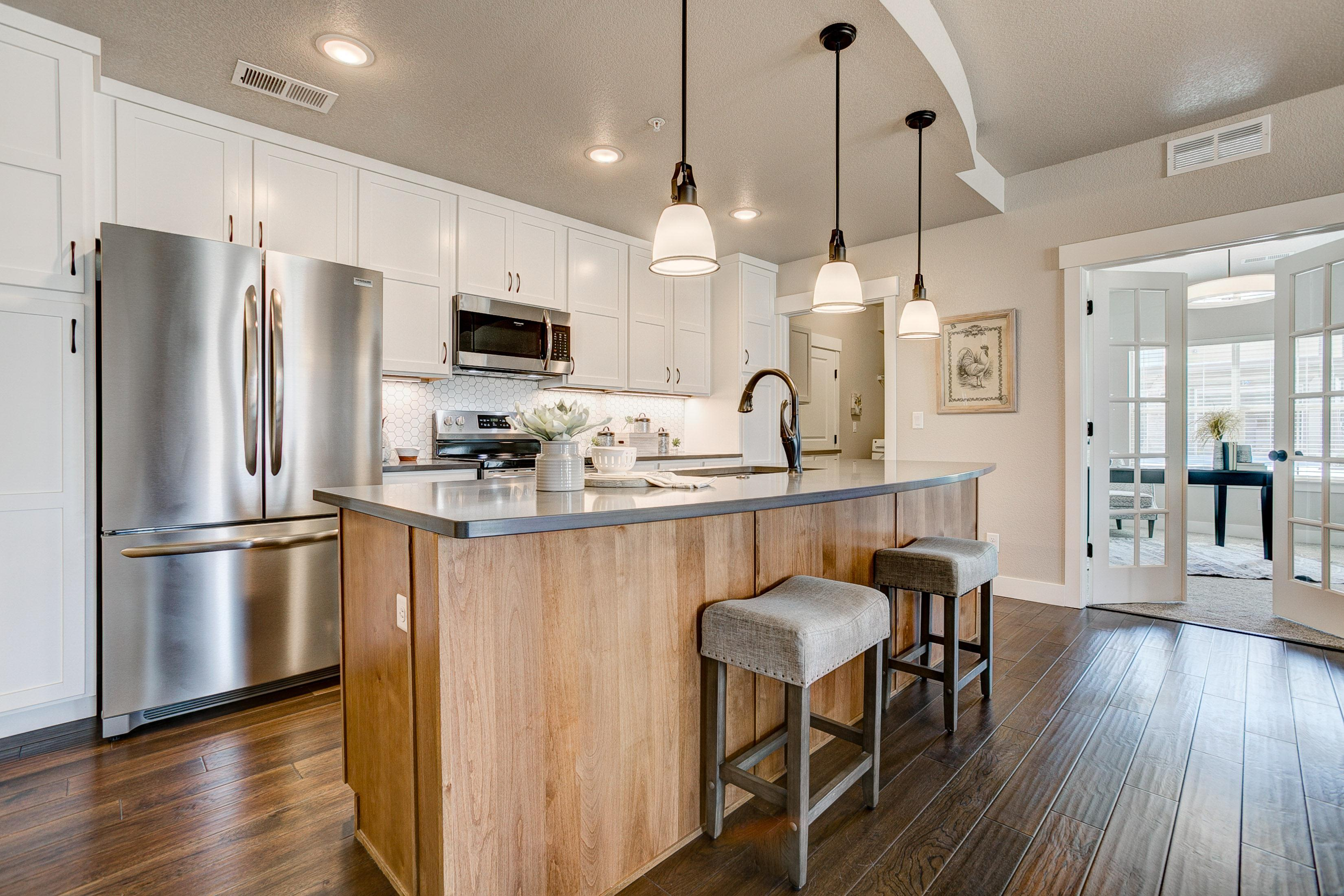 Kitchen featured in the Cambridge By Landmark Homes  in Fort Collins-Loveland, CO
