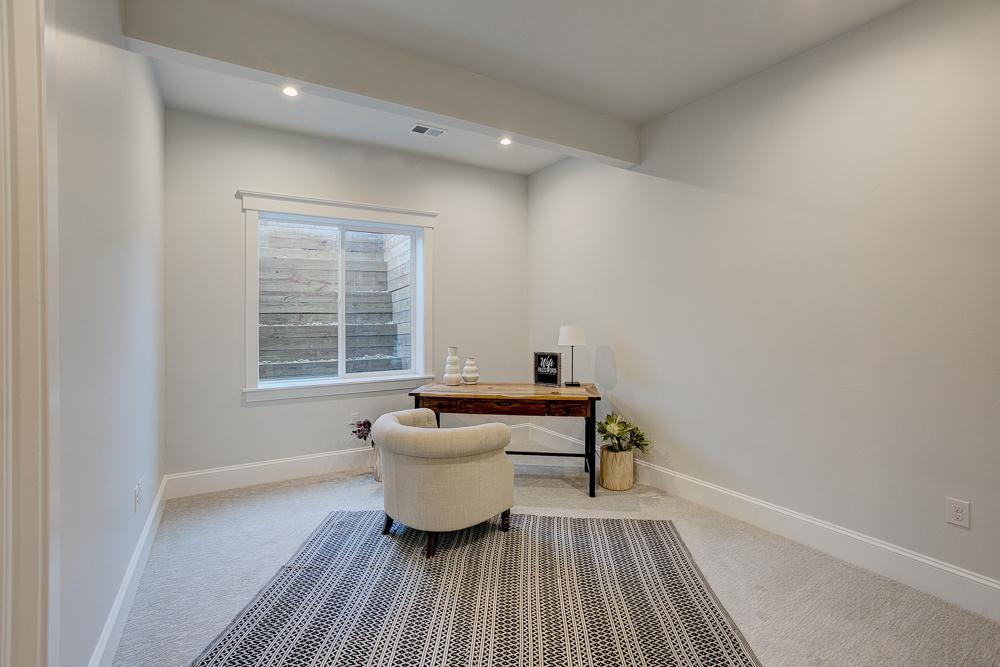 Living Area featured in the Ravenna By Landmark Homes  in Greeley, CO