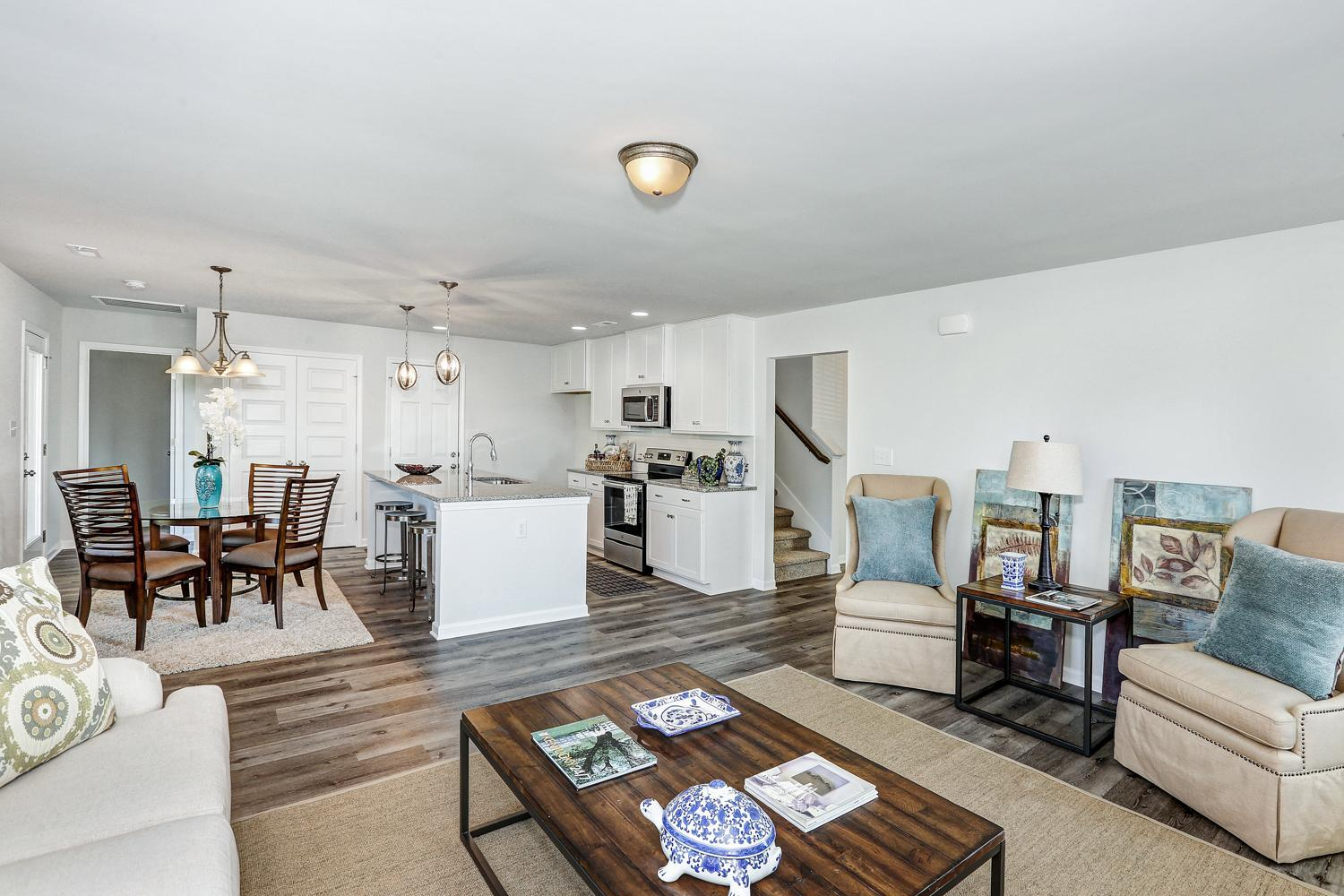 Greatroom-and-Dining-in-The Williamsburg-at-Burwell Gardens Freedom Series-in-Harvest
