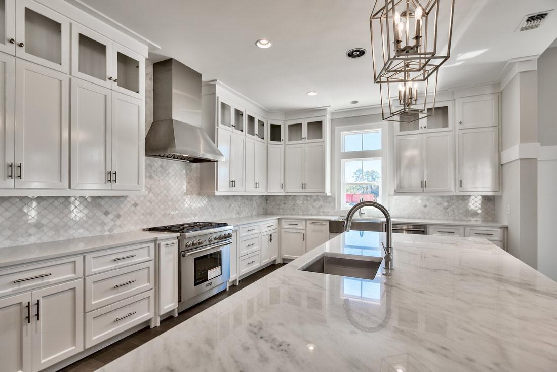 Kitchen featured in The Natchez By Destin Custom Home Builders in Destin-Fort Walton Beach, FL