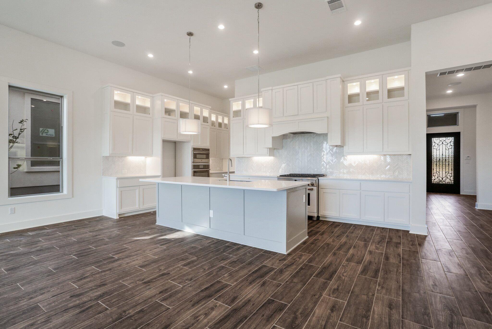 Kitchen featured in the Granada By Village Builders in Austin, TX