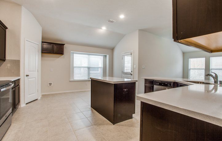Kitchen-in-Bluebonnet-at-Reserve at Chamberlain Crossing-in-Fate