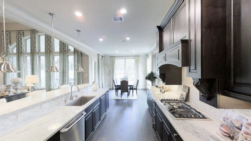 Kitchen featured in the New Haven II By Village Builders in Houston, TX