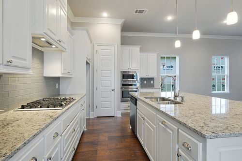 Kitchen-in-Krauss II-at-Americana by Level Homes-in-Zachary