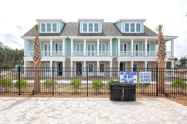Townhomes Front Exterior:Townhome C is conveniently located by the community pool