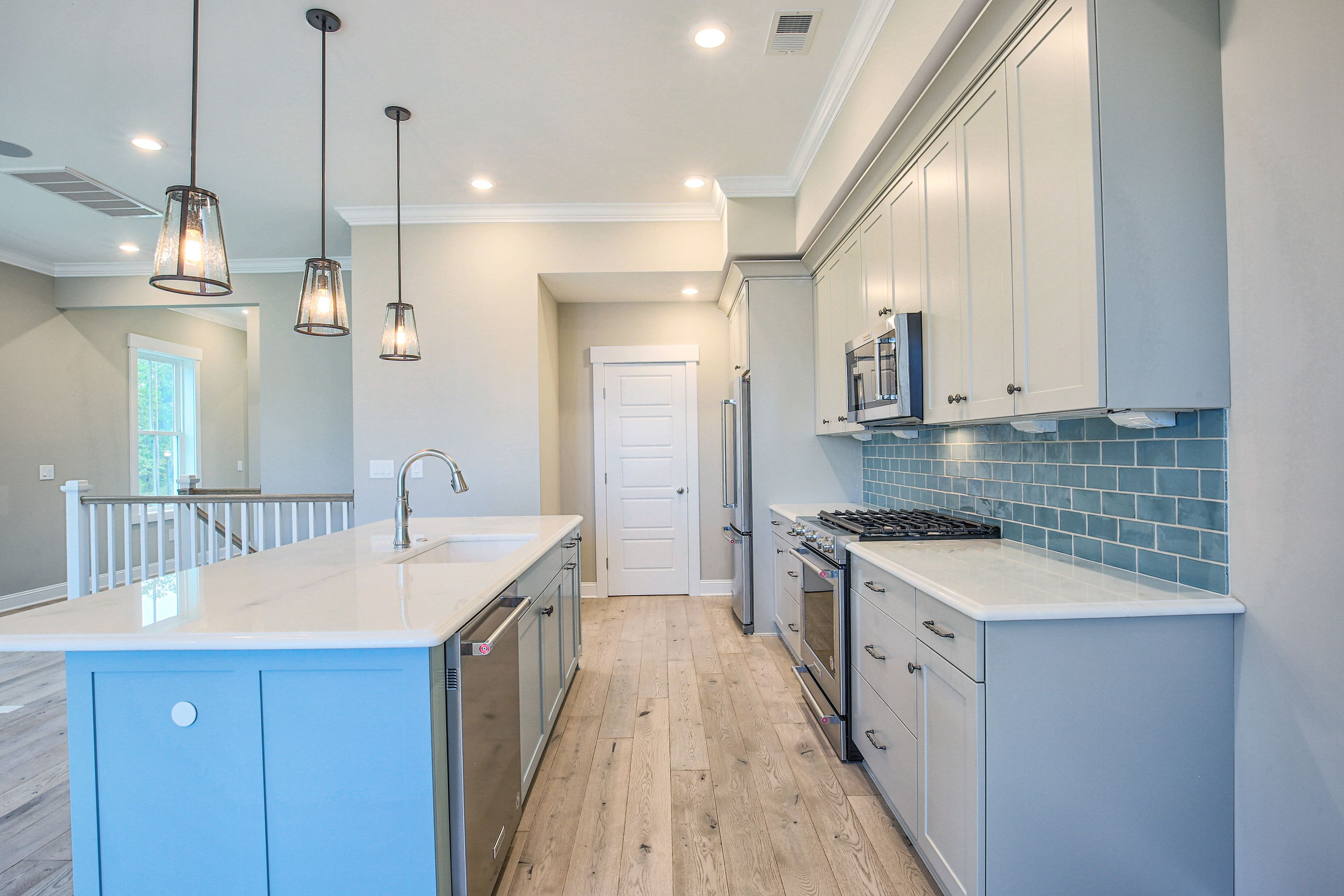 Kitchen featured in the Three Story Wraparound Porch Townhome By CRG Companies in Myrtle Beach, SC