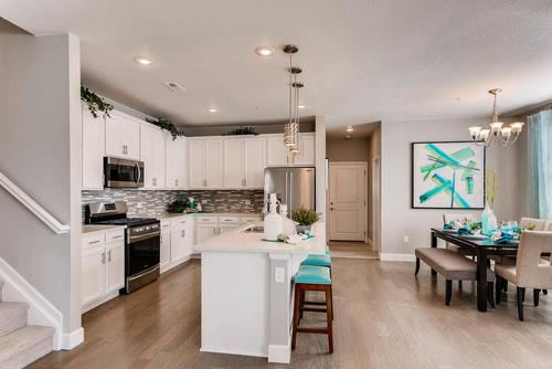 Kitchen-in-The Emma-at-The Villas at Wheatlands-in-Aurora