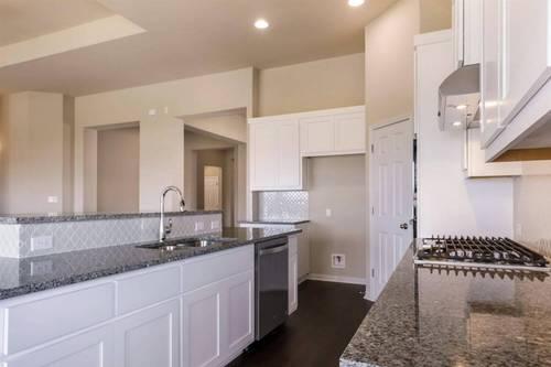Kitchen-in-Oxford-at-Tierra Rosa at Santa Rita Ranch 60'-in-Liberty Hill