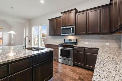 Kitchen-in-Ashville III-at-Lakeside at Tessera on Lake Travis 70'-in-Lago Vista