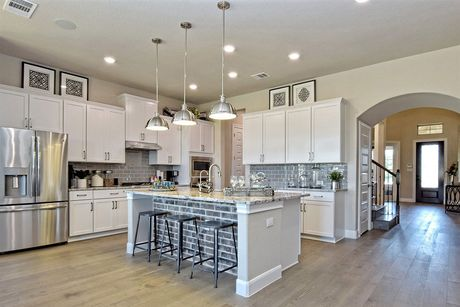 Kitchen-in-Persimmon-at-Trails At Helotes-in-Helotes