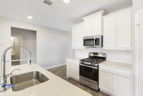 Kitchen-in-Bridgeport-at-Rosehill Reserve-in-Tomball
