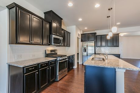 Kitchen-in-Newport II-at-Heritage At Neel Ranch-in-Mooresville