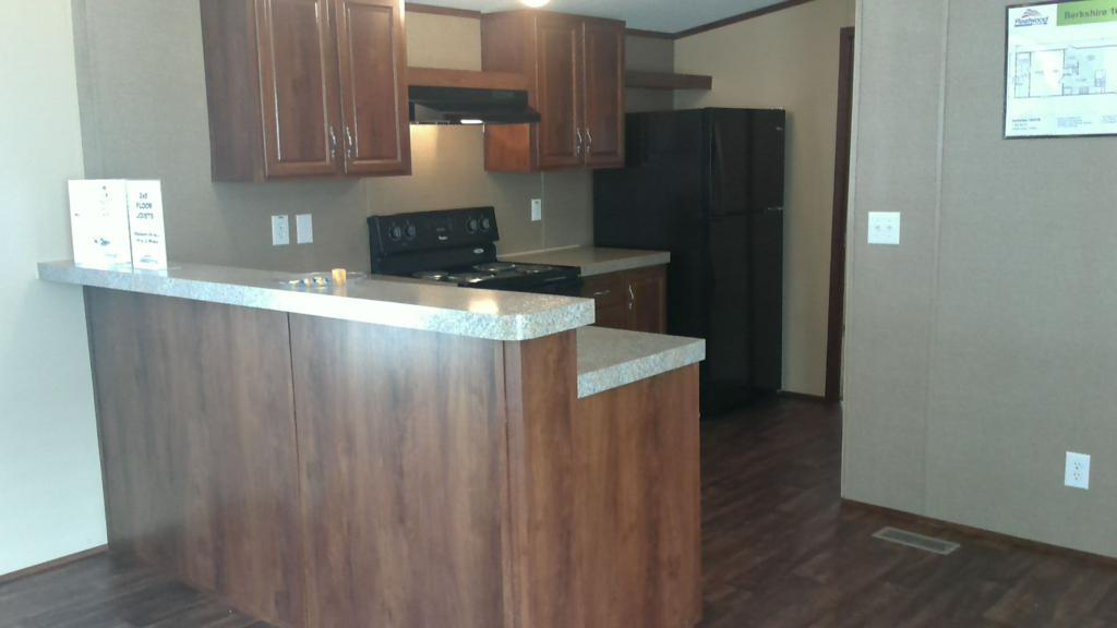 Kitchen featured in The Berkshire By Manufactured Housing Consultan in San Antonio, TX
