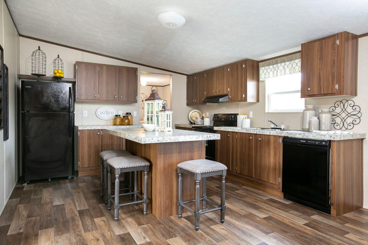 Kitchen featured in The Triumph By Manufactured Housing Consultan in Corpus Christi, TX