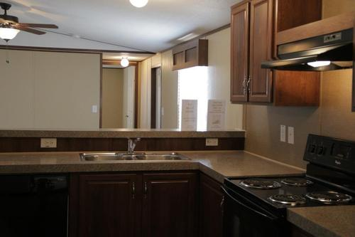 Kitchen-in-The Berkshire-at-Manufactured Housing Consultants - Laredo-in-Laredo
