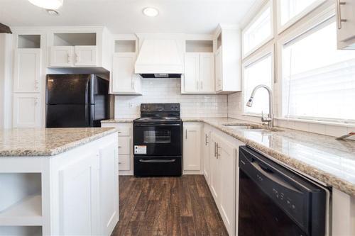 Kitchen-in-The Bradley-at-Manufactured Housing Consultants - Von Ormy-in-Von Ormy