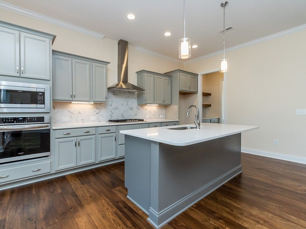 Kitchen featured in The Swansboro By Meadow Bluffs in Raleigh-Durham-Chapel Hill, NC