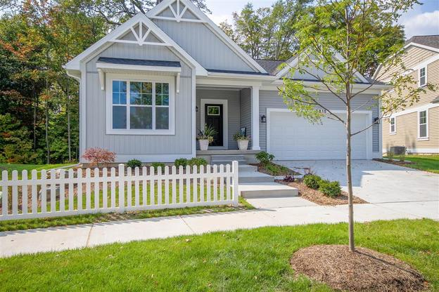 The Newport by Mayberry Homes:Welcome to the Newport. This beautiful new floor plan offers a wonderful layout tucked comfortably into 1732 square feet. The open concept living area boasts a Great Room, Formal Dining, Cafe, and gourmet kitchen, which makes for great entertaining possib