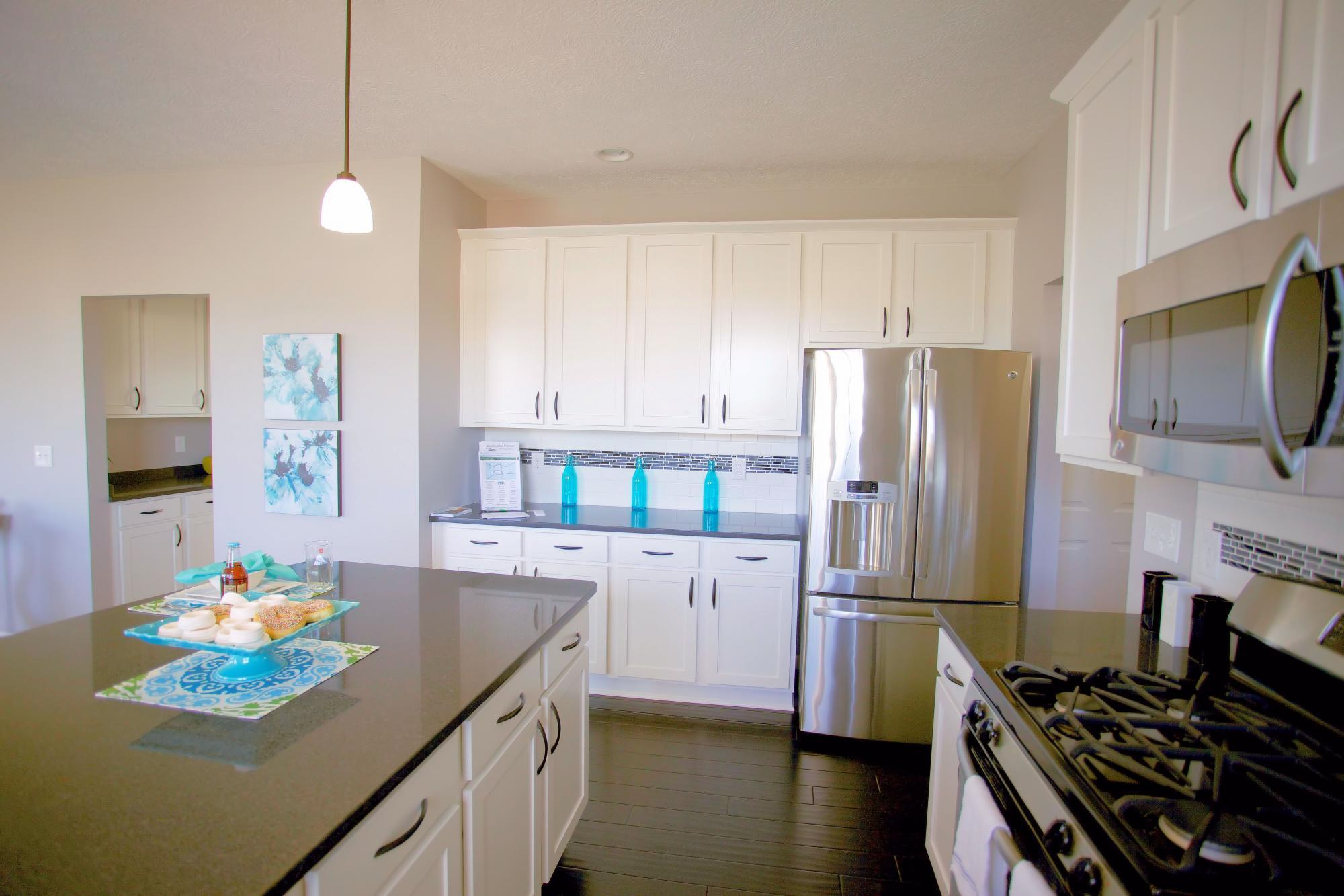Kitchen featured in the Woodbury By Mayberry Homes in Lansing, MI
