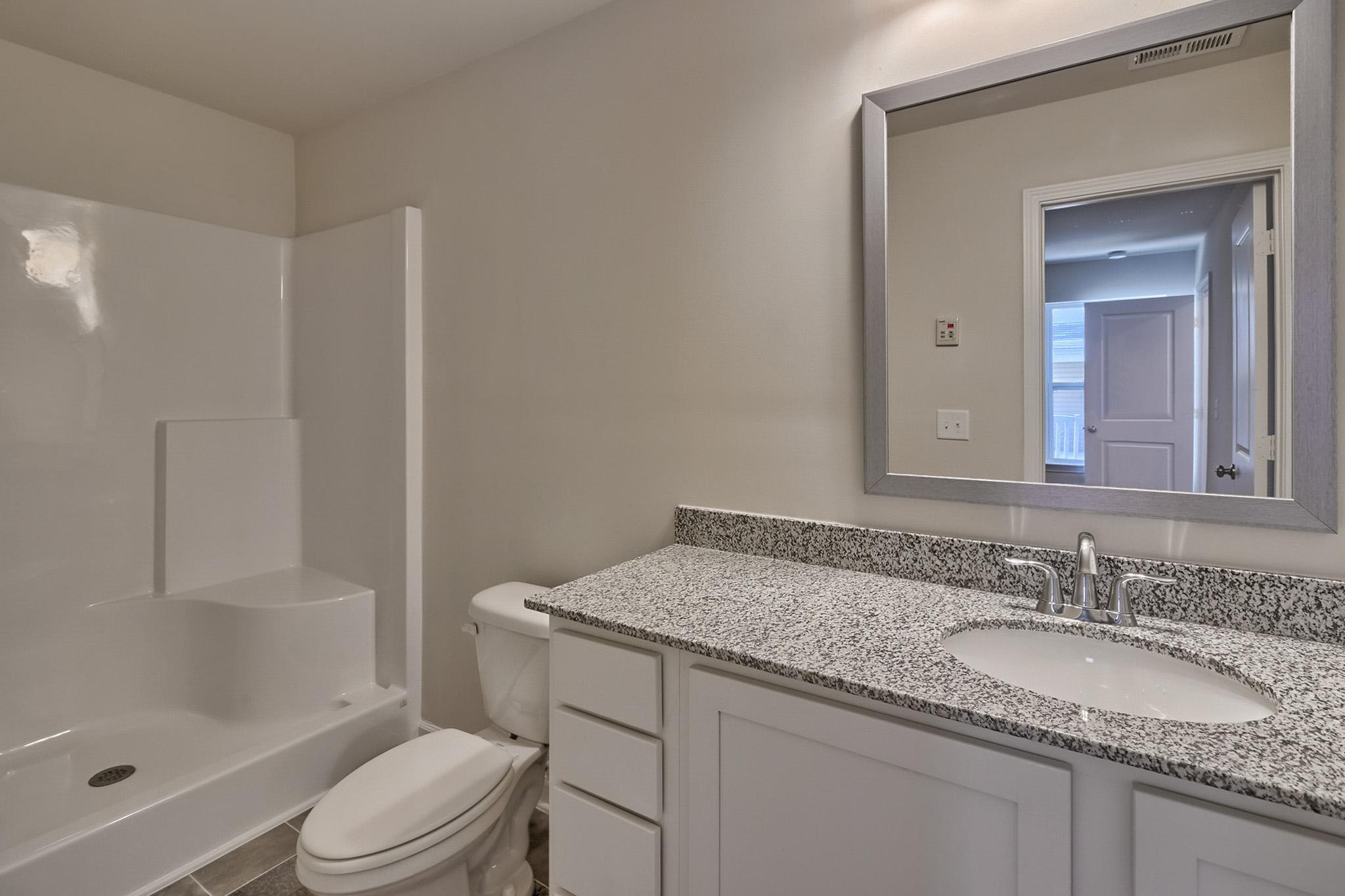 Bathroom featured in the Dogwood By McGuinn Hybrid Homes in Columbia, SC