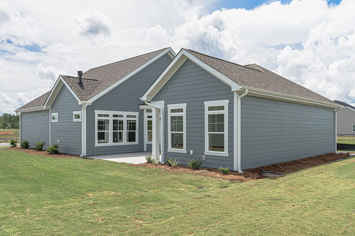 Exterior featured in the Portico Craftsman By McKee Homes in Wilmington, NC