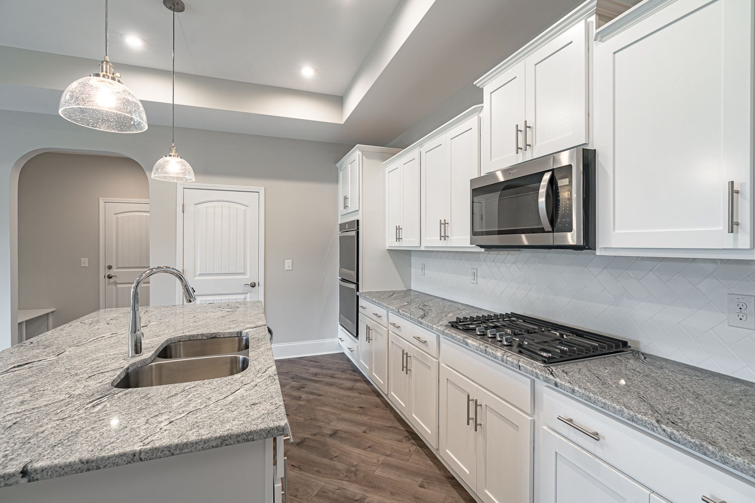 Kitchen featured in the Promenade Craftsman By McKee Homes in Wilmington, NC