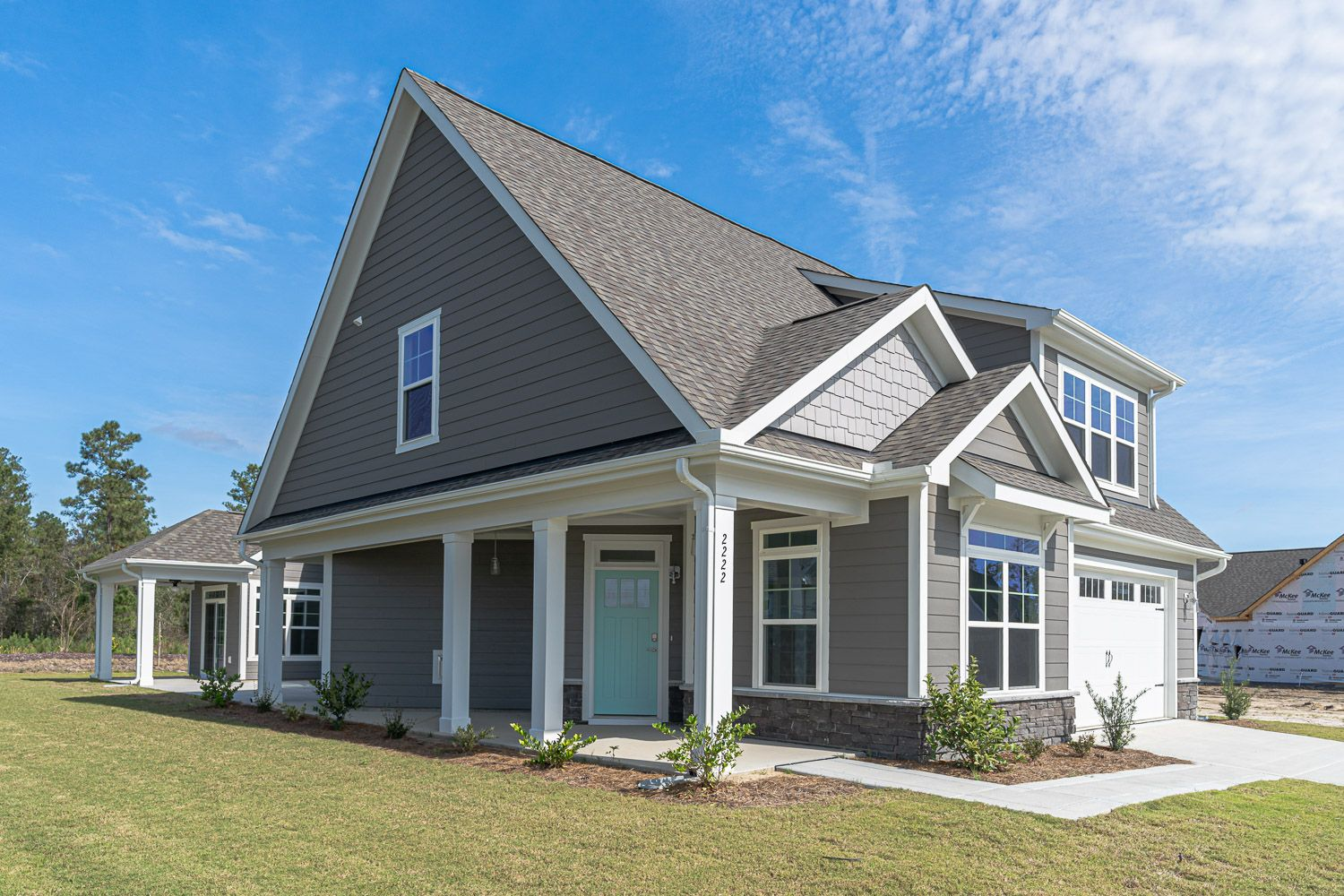 Exterior featured in the Promenade Bungalow By McKee Homes in Wilmington, NC