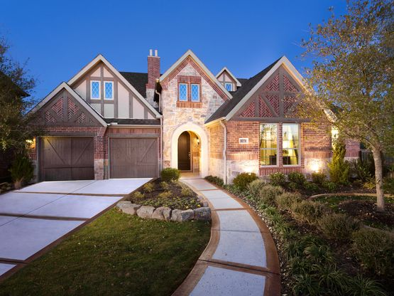 The gorgeous Zinnia plan comes with a stunning courtyard and three car garage.