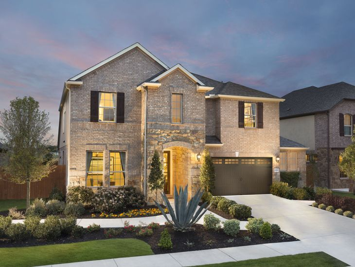 You'll love coming home to the impressive Spanish Oak plan