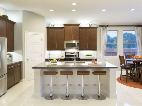 Kitchen-in-The Holly-at-Terrace Oaks - Reserve Series-in-Corinth