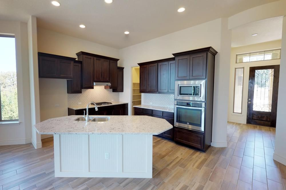Kitchen featured in the Adams : 50-2127F.1 By Monticello Homes in San Antonio, TX