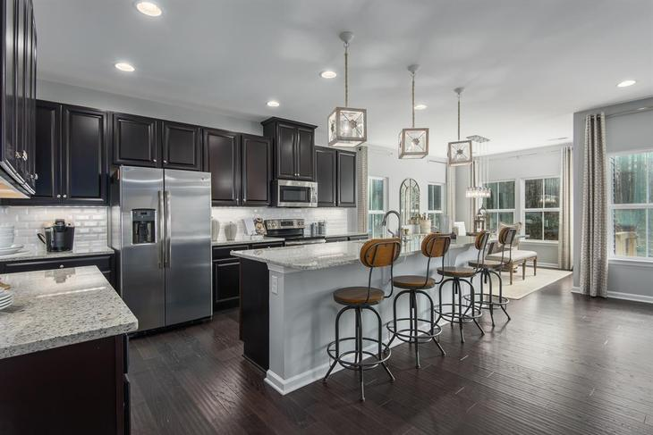 Downsize without the sacrifice:Your last chance to own these maintenance-free townhomes with included lawn care in the prestigious Five Forks area.Schedule your visit!