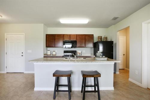 Kitchen-in-F1718-at-Stoneridge at Ayersworth Glen-in-Wimauma