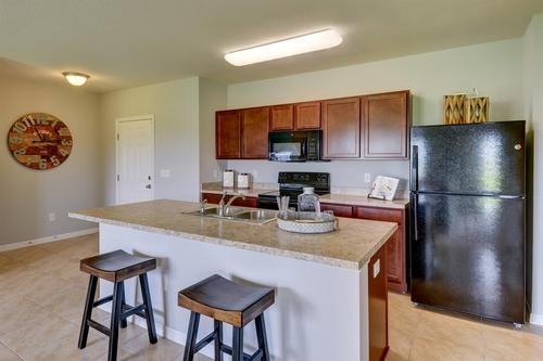 Kitchen-in-F1718-at-Stoneridge at Ayersworth Glen-in-Wimauma