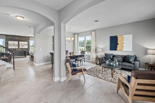 Greatroom-and-Dining-in-Estero Bay-at-Champions Reserve-in-Davenport
