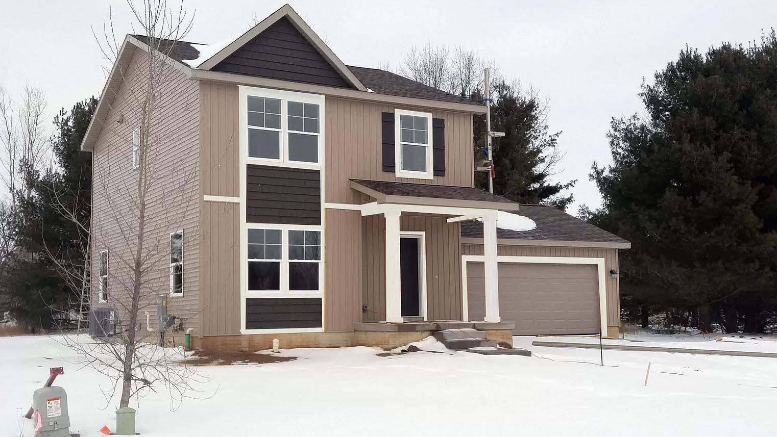 Exterior featured in the Ashford By Oak Ridge Homes in Lansing, MI