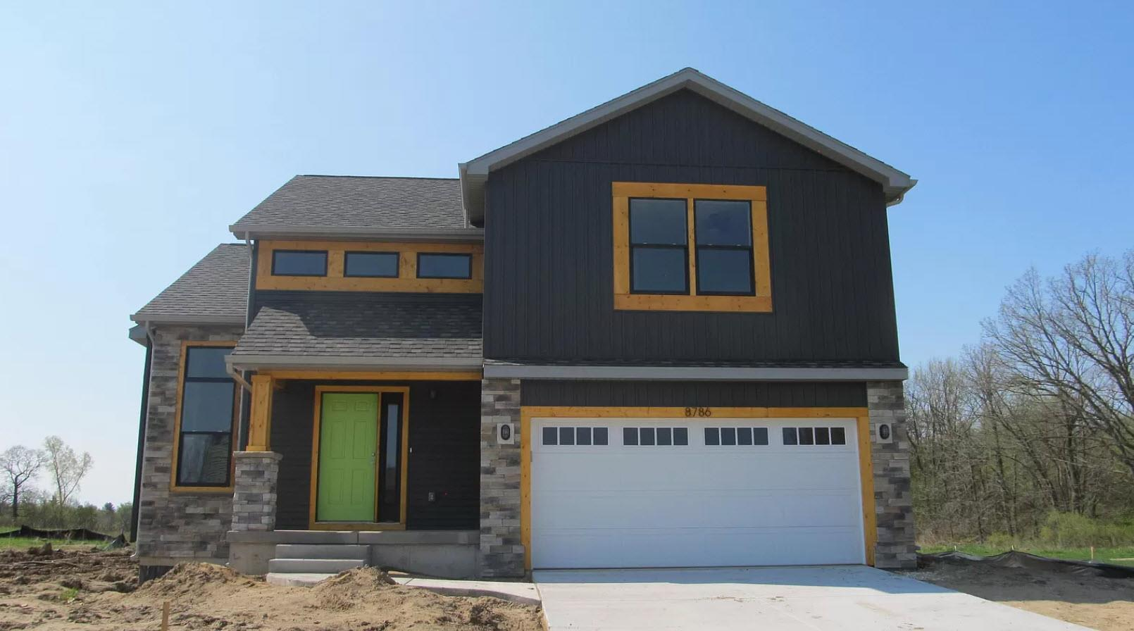 Exterior featured in the Stanford IV By Oak Ridge Homes in Lansing, MI