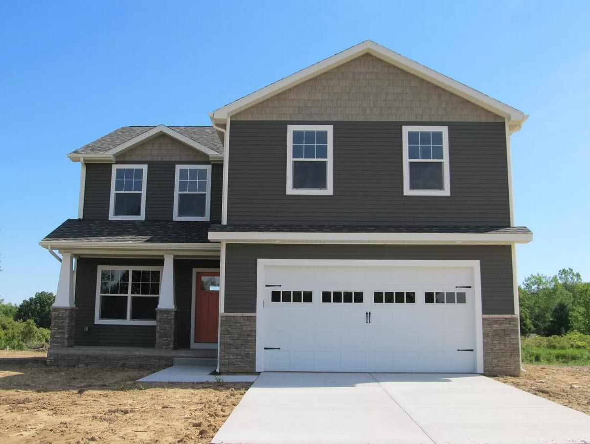Exterior featured in the Wellington By Oak Ridge Homes in Lansing, MI