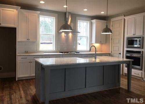 Kitchen-in-Hilliard-at-12 Oaks by Saussy Burbank-in-Holly Springs