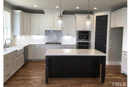 Kitchen-in-Tanner-at-12 Oaks by Saussy Burbank-in-Holly Springs