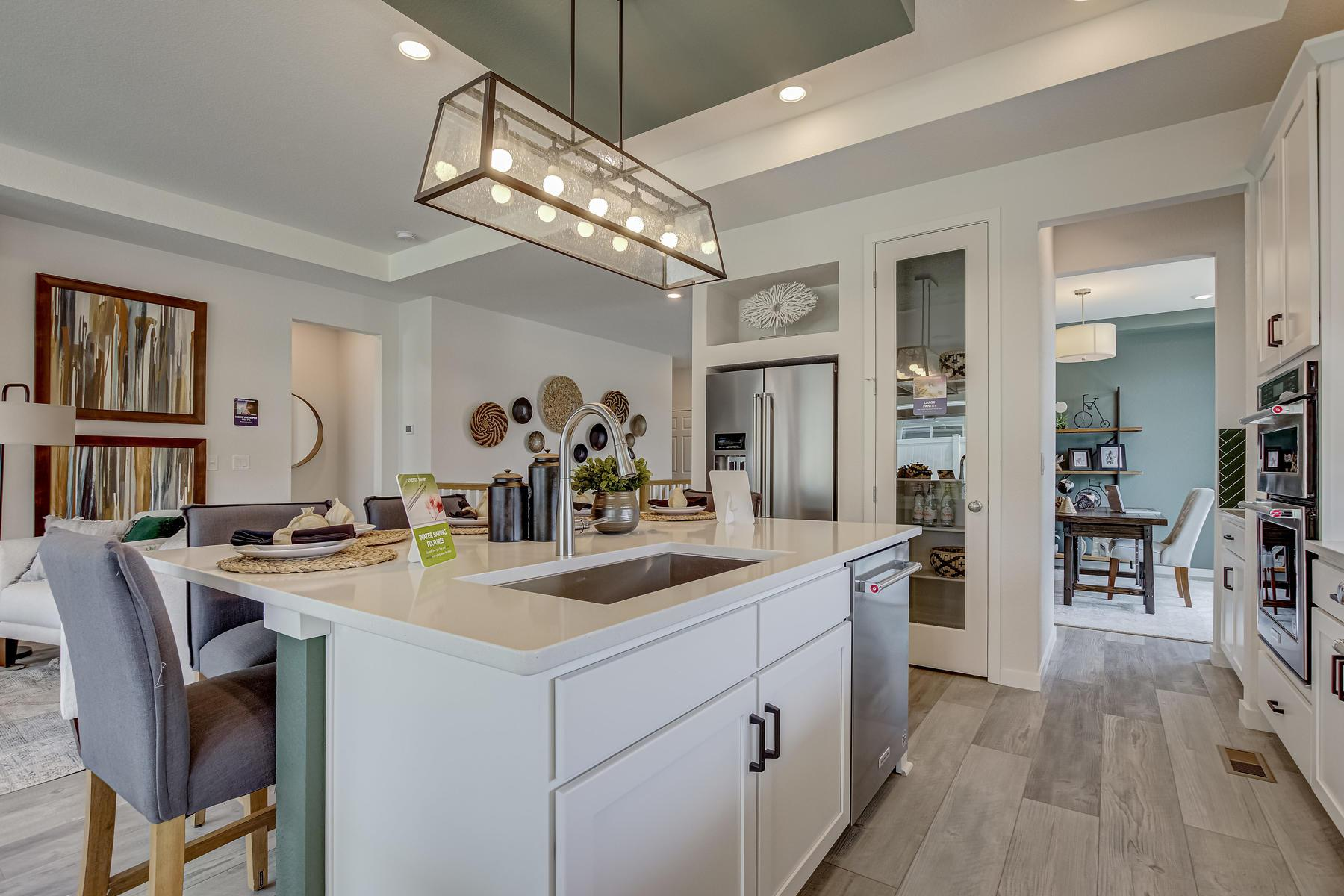 Kitchen featured in the Crestone By Oakwood Homes in Fort Collins-Loveland, CO